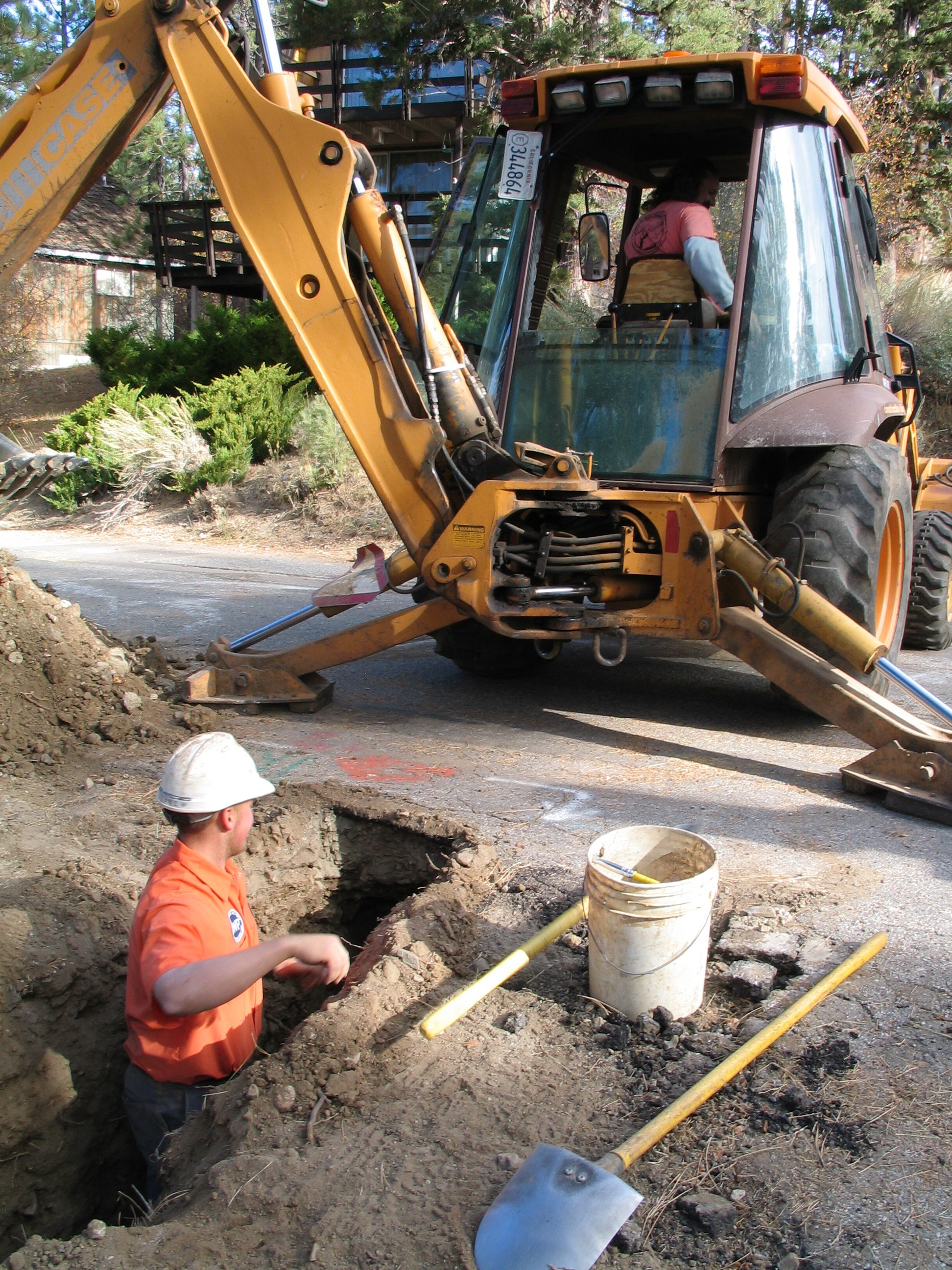 Large Equipment Digging Hole With Worker